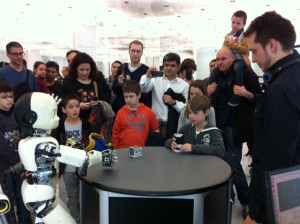 iCub playing pong with children